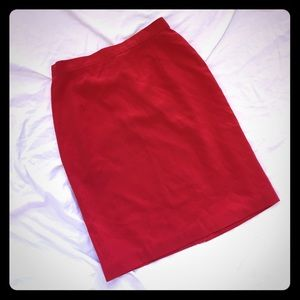 Red skirt with backslit and built in slip